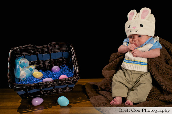 Brady Easter Photoshoot with basket, rabbit, and easter eggs